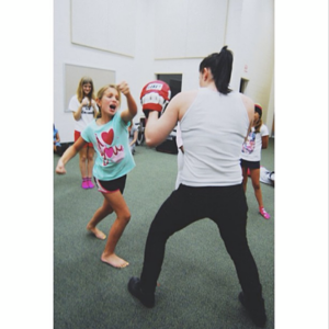 Counselor Mollie teaches campers how to kick butt during a self defense workshop!